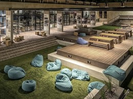 Students' leisure area at Newcastle Uni features Outdure decking and turf
