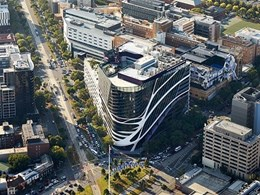 Melbourne cancer care facility sky signs stand out against striking Lysaght cladding