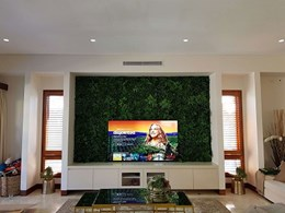 Green wall backdrop in Sydney home's movie room
