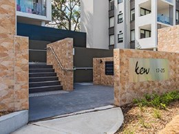 Modular retaining panels help create sturdy block walls for apartment complex garden