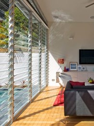 Multiple bays of Altair louvre windows connect indoors and outdoors at Coogee House