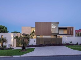 Timber look aluminium battens complement natural surrounds at new Perth home