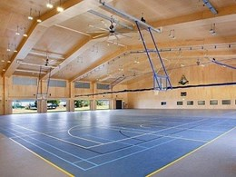 QLD school sports facility stands out with warm timber panelling