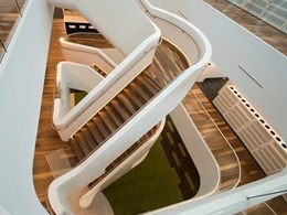 Staircase clad in Corian is centrepiece at Ego Pharmaceuticals HQ