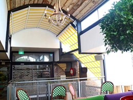 Old retractable roof replaced with retractable curved awnings at Erskineville hotel