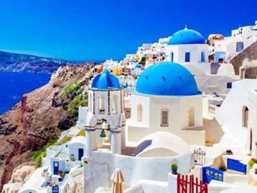 White buildings in the village of Oia on the Greek island of Santorini. Image: Shutterstock
