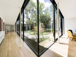 Massive glass panes maximise views into landscaped courtyard at Hawthorn House