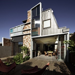 Warehouse style home takes top award in bdav building for Warehouse style house plans