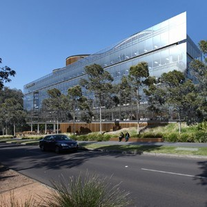 Glass Box Anchored By Sinuous Forms Is Face Of Novartis