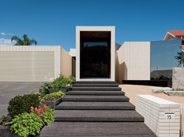 Melbourne home sits on moat of sand and features multiple-volume façade
