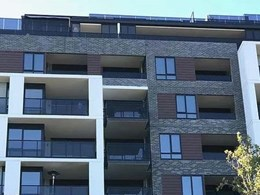Stone brick tiles balancing art deco with modern edge on St Kilda apartment façade
