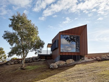 The sculpted corten form that frames the landscape perfectly