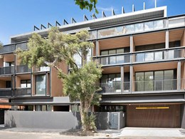 Timber look cladding and concrete facade adds modern edge to St Kilda apartments