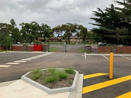 Trackless retractable gates installed at driveway entrance