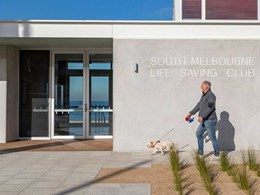 Custom concrete paving enables clubhouse to blend with foreshore setting