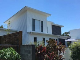 Weatherboard-style cladding meets brief for Noosaville townhouses