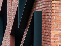 Signature facade on Collingwood apartments features brick inlay