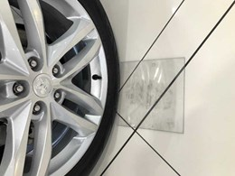 Polycarbonate pads protecting car showroom floors