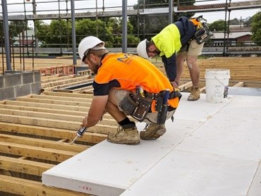 MaxiFloor being installed in a new apartment block in Preston, SA (Photographer: Mannix Photography)