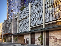 Cobble effect custom facade provides solar shading for Ritz Carlton