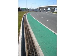ACO's PowerDrain system with heavy duty anti-shunt boltless locking grates used on Airport Link drive flyover