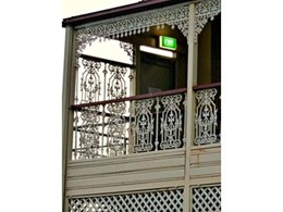 Cast iron lacework and balustrade restore the charm of an old house