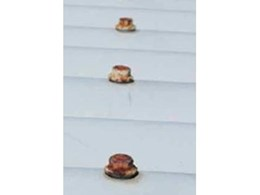 How poor quality washers can cause corrosion on metal roofs