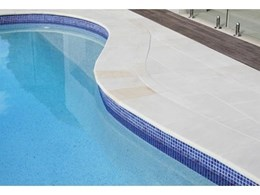 Mint White honed sandstone from Cinajus provides smooth pool surround