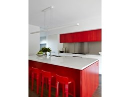 Red lacquered Artek K65 stools from Anibou spice up kitchen for Melbourne home