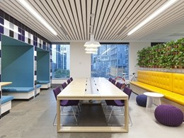 Fun activity-based workspace enriched by weathered slat ceiling