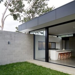 DKO Architecture plugs contemporary glazed box into back of subdued art deco bungalow
