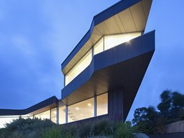 Dramatic, angular home looms over the Victorian coast