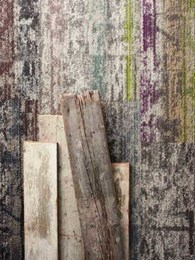 New carpet tiles inspired by aged timber and concrete to meet contemporary design goals