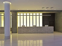 Marblo's Opal series solid surface featured on wall panels and bar top at Avasa, Hyderabad