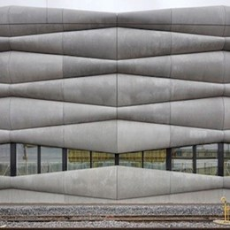 Zigzagging cement panels cover new railway service facility in Zurich