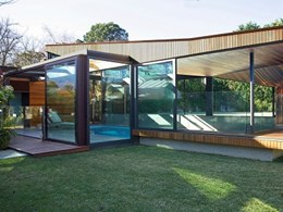 Melbourne poolhouse with vented roof, sliding walls and glazing ensuring year round use
