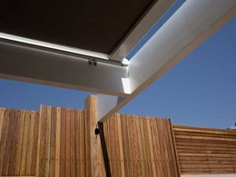 Aalta patio awning helps homeowner keep the deck cool and classy