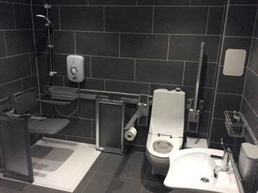 An accessible bathroom with Pressalit wall track system