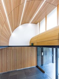 PJ Maitland Design transforms entry areas with curved timber slats
