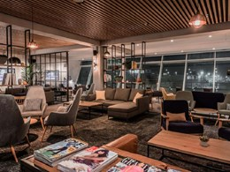 Slatted acoustic ceiling completes cosy airport lounge
