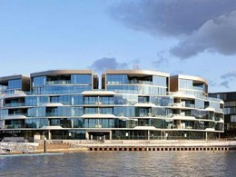 Curved facade on luxury apartments wrapped in Alspec's premium glazing systems