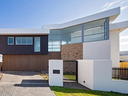 Timber look façade conceals entrance and garage at Cronulla home