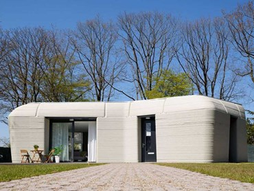 The 3D-printed concrete house in Eindhoven is boulder-shaped with load-bearing walls