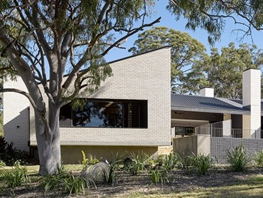 The Three Chimney House features Crevole bricks on interior and exterior walls