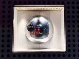 Acrylic mirror domes add futuristic aesthetic to Hermès window display