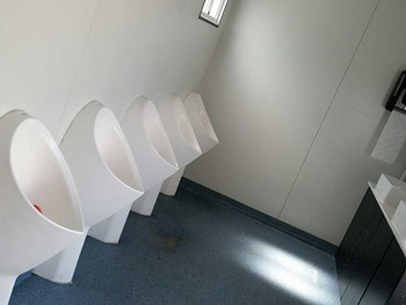 VIP bathroom featuring the Uridan Admiral waterless urinals