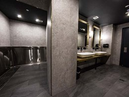 Stainless steel Britex Sanistep L-shape urinal installed at the Albion Hotel