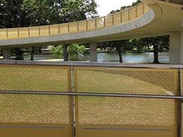 Perforated panels on new Hassell-designed bridge over Anzac Parade anodised by Universal