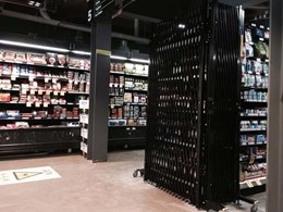 ATDC's portable expanding barricades securing liquor aisles at Woolworths Metro store