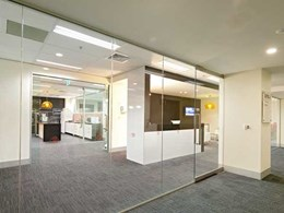 Artesian frameless glass sliding system and aluminium partitioning create breakout room for Melbourne property company
